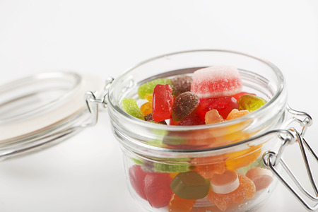 Glass jar full of goodies. Isolated. Stock Photo