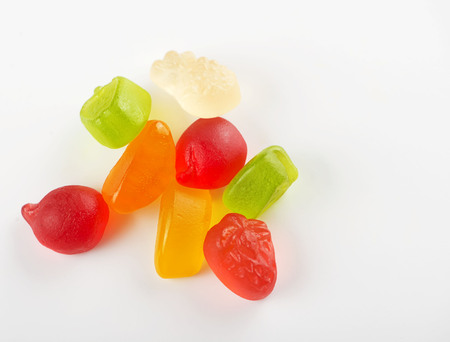 Sweets of various flavors and colors. Isolated. Horizontal shoot. Stock Photo