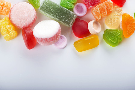 Close-up of candies and candies of various types and flavors. Isolated. Copy-space Stock Photo