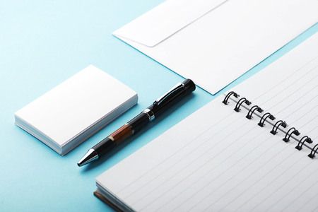 Office supplies on blue background. Mockup. Stock Photo