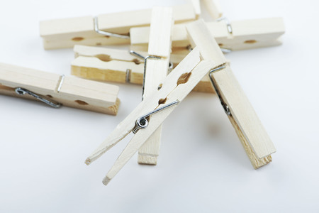 Various wooden clothespin on white background. Isolated. Horizontal shoot.