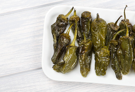 white wine: Fried green peppers. Spanish gastronomy. Food.