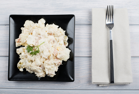 tuna mayo: Typical dish of spain, russian salad with fork. Mediterranean diet.