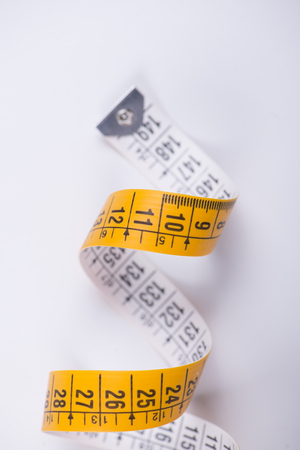 Measuring tape on white background. Isolated. Stock Photo