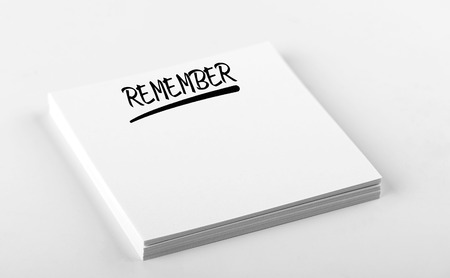 Concept of note with the word Remember written on white paper. Mockup.