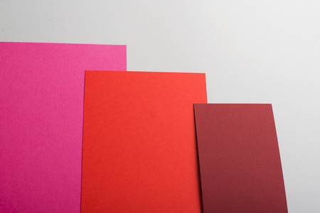 Cardboards of various colors on gray background. Mockup.