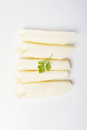 Slices of cheese on white background. Isolated. Foto de archivo