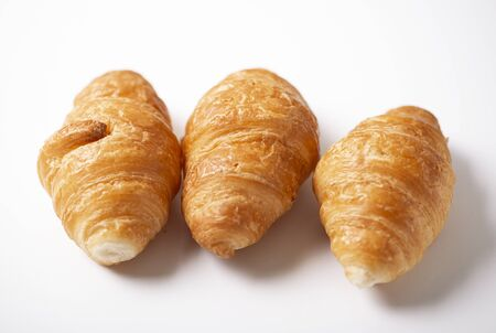 Croissants on white background.