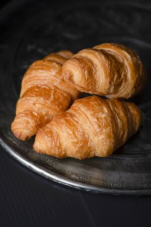 Croissants on metal tray.