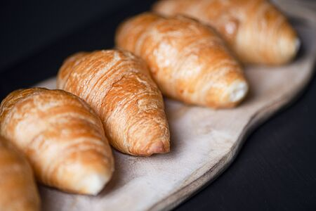 Croissants on wooden board. Banco de Imagens