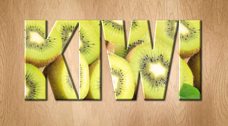 Kiwi word covered with Kiwi fruit on a kitchen cutting board