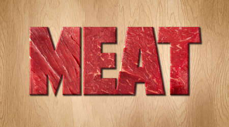 Meat word covered with raw meat texture on a wooden cutting board