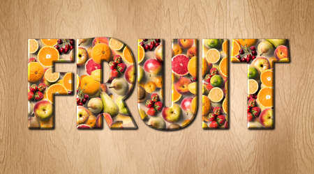 Fruit word covered with various fruits on a kitchen cutting board Banco de Imagens