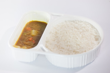 Take away food, Thai curry Massaman with rice isolated on white photo