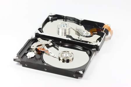 sata: pair of  hard disk compair between  sata harddisk in front  and ide harddisk back one  on white backgound Stock Photo