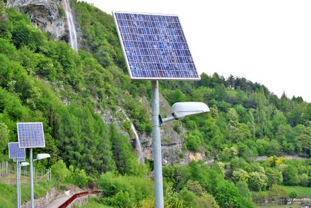 solar panels to produce electricity using the suns rays to illuminate the mountain road