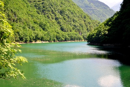 mountain lake of fresh water produced for the production of electricity photo