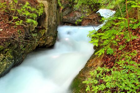 land which is fresh water with a waterfall and rushing noise coming from the Alps photo