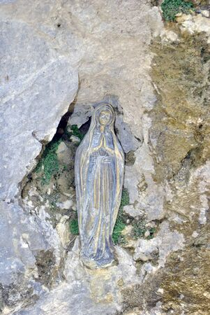 pardon: small states of the Virgin Mary in the dolomite Stock Photo