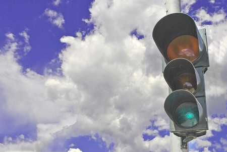 traffic signals with the background sky and clouds photo