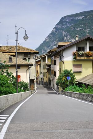 country road with old buildings typical of rural Italian photo