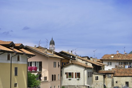 small town with a bell tower and residential buildings with blue sky photo