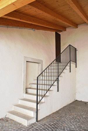 white cement staircase with wooden roof beams and pine photo