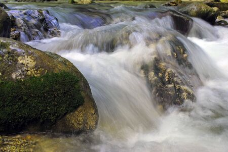 pure and sparkling waterfall with rocks
