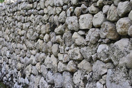 wall of round stones and propped embedded photo