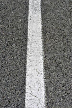 white line on black asphalt photo