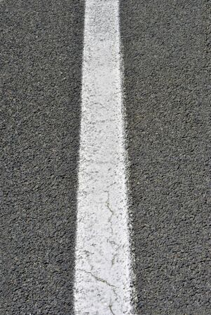 white line on black asphalt photo