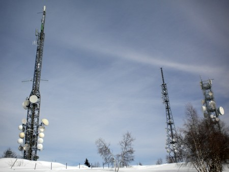 data transmission: winter landscape with snow and pine trees ground antennas for data transmission and mobile TV