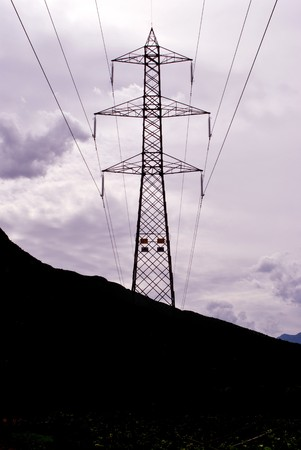 high voltage tower on top of the hill surrounded by greenery Stock Photo - 7789224