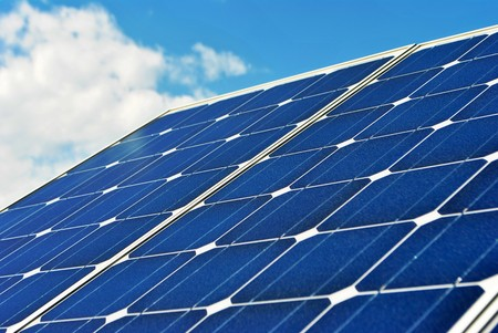 Solar Panel with background blue sky and white clouds