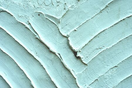 texture with white cement and plaster bas relief lines and spatula photo