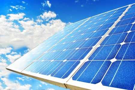 Solar Panel with background blue sky and white clouds photo