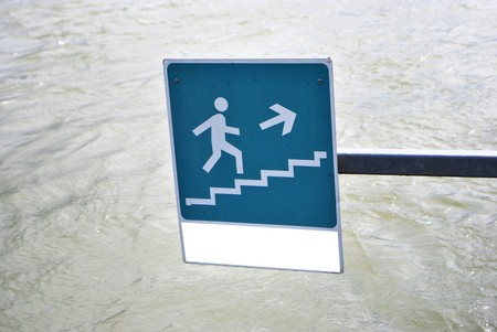 indicating an emergency exit in the water channel photo
