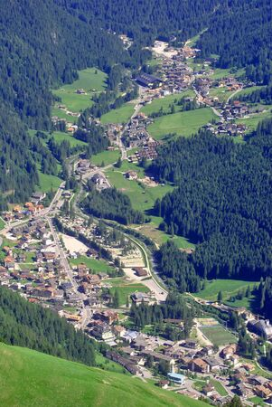 small town  in mountain valley with green pine Stock Photo - 7789497