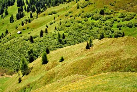 Aerial view of Canazei and Fassa valley with Saas Pordoi mount (Sella group) Pordoi pass and Fedaia pass dolomiti  Stock Photo - 7899773