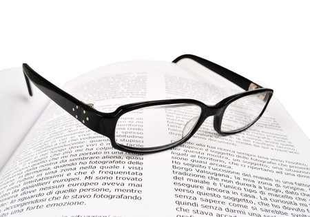 book written in Italian with glasses blacks