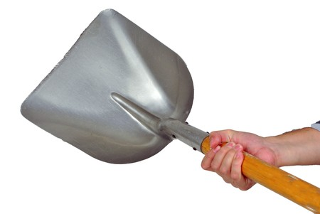shovel the snow with human hands Stock Photo