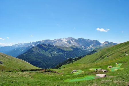 valley overlooking green fields montange background photo