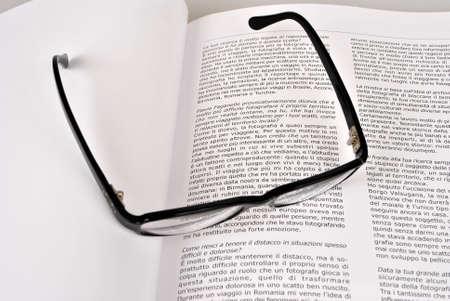 clearer: book written in Italian with glasses blacks