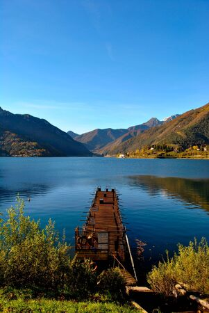 mirror lake with wooden pier surrounded by beautiful mountains Stock Photo - 8306453