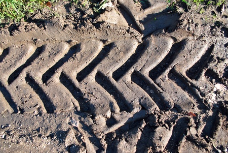 imprints of the tractor on the ground