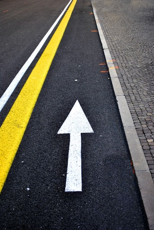 lane lines: white arrow lane asphalt road