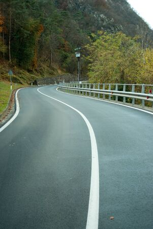 asphalt road with the white line in center Stock Photo - 8543023