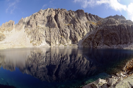 blue mountain lake with a reflection on the background of the Dolomites mountains Stock Photo - 8611242