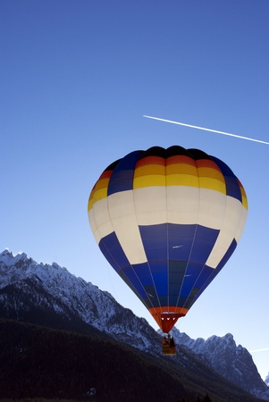 Hot Air Balloon Festival in the Italian Dolomites, preparation before flying in the blue sky photo