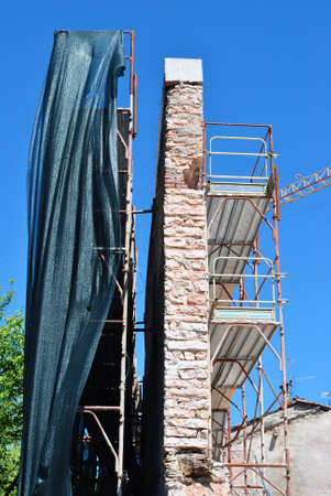 rebuilding the wall with piers and metal safety net fall photo